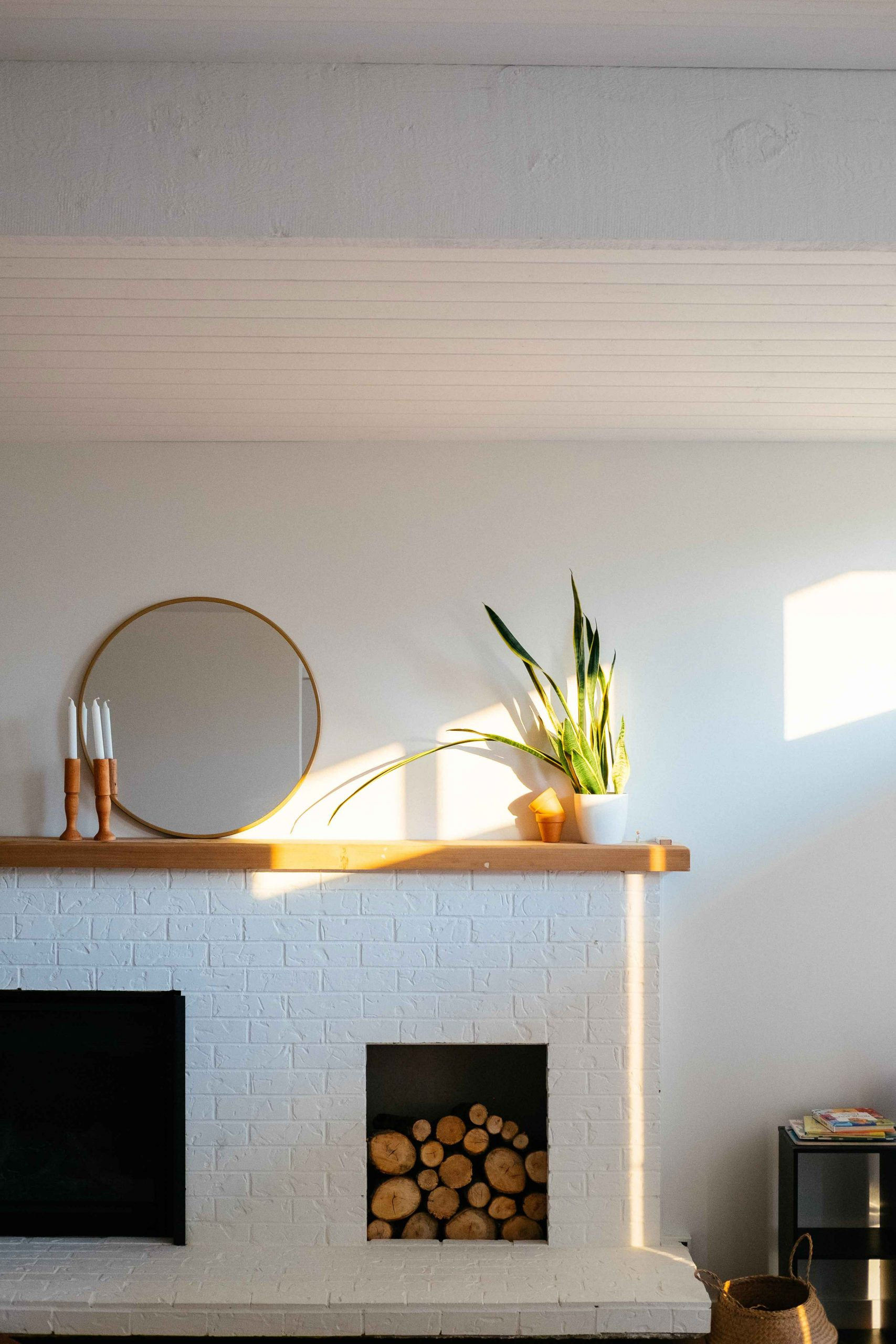 how to hang a mirror over a fireplace